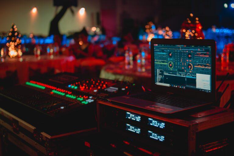 black-laptop-beside-audio-mixer-set-919734